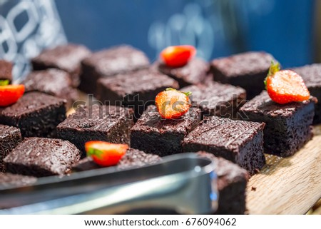 Homemade Chocolate Nut Brownie Cake decorated with Strawberries in Luxury Restaurant for Brunch
