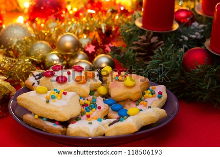 Homemade christmas cookies and advent wreath - stock photo