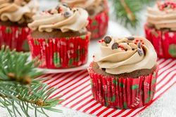 Homemade christmas cupcakes with sprinkles decoration. Festive sweet treats, Christmas dessert