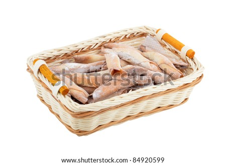 Homemade cookie roll in a wattled basket, isolated on white background