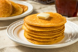 Homemade Corn Meal Johnny Cakes with Butter and Syrup