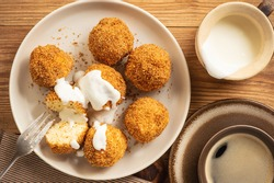 Homemade cottage cheese balls, hungarian sweet dessert served with sweat fraiche creme.