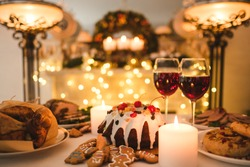 homemade cozy evening couple dessert concept. kitchen traditions. delicious holidays food and candles light
