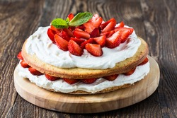 Homemade cream layer cake, fresh, colorful, and delicious dessert with juicy strawberries,  sweet whipped cream and cream cheese