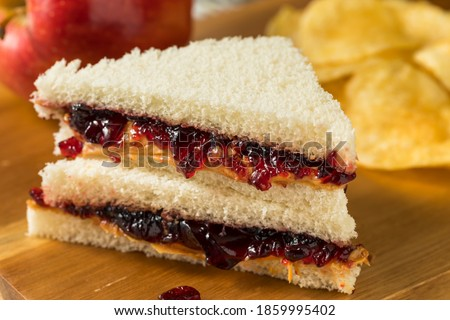Homemade Crustless Peanut Butter and Jelly Sandwich with Chips Stock photo ©