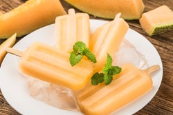 Homemade delicious ice lolly of cantaloupe melon. Healthy summer dessert.