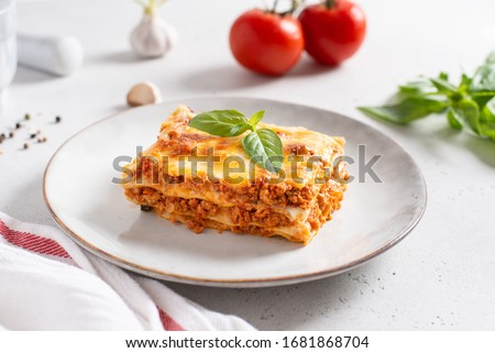 Homemade delicious Meat lasagna with basil leaf on the top. Close up. Recipe, menu. Italian cuisine. Side view