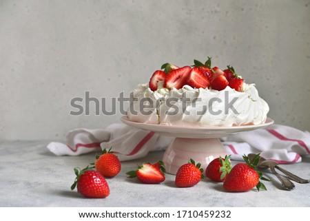 Homemade delicious meringue cake 'Pavlova' with fresh straberry and mascarpone on a white background. Stock photo ©