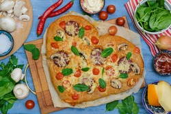 Homemade Delicious pizza heart for Valentine's Day made of yeast-free dough with vegetables,tomatoes,herbs and cheese,prepared at home for festive dinner.Step by step recipe.Instructions. DIY. Step 14