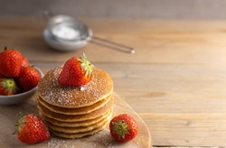 Homemade dessert pancakes with strawberry's and syrup