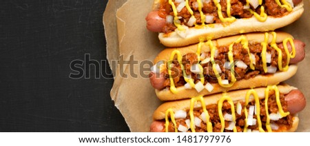 Homemade Detroit style chili dog on a black background, top view. Flat lay, overhead, overhead. Copy space.  #1481797976