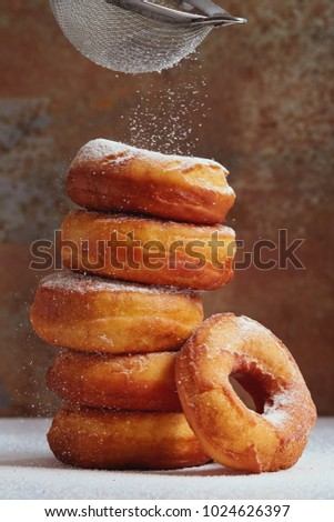 Homemade donuts sprinkled with powdered sugar