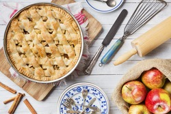 Homemade Dutch apple pie and ingredients on a rustic table. Photographed from directly above.
