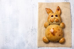 Homemade Easter Baking. Easter Bunny Bun on light gray textured background, flat lay, space