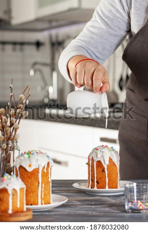Homemade Easter cake with  traditional decoration. Easter concept. Woman holds Easter pastries stock photo