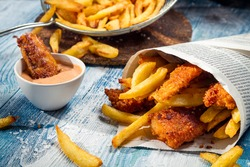 Homemade Fish & Chips in newspaper