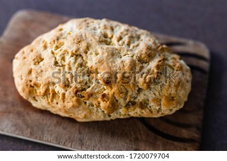 homemade food recipes concept, damper soda bread on cutting board Stockfoto ©
