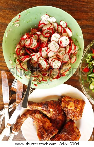 homemade food: salads and grilled chicken served over wooden tables