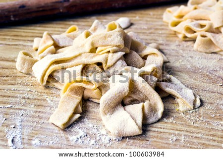 Homemade fresh strips of dough for Tagliatelle - stock photo
