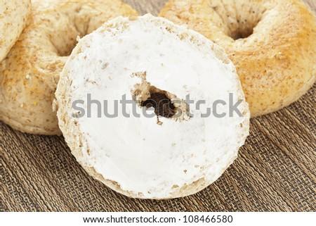 Homemade Fresh Whole Grain Bagel with cream cheese - stock photo