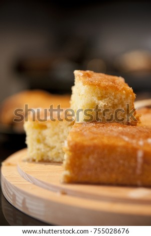 Homemade freshly baked Lemon Drizzle Cake on a Cafe Stlye Counter