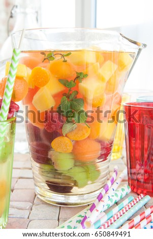 Homemade fruit punch with colorful fruits and mint #650849491