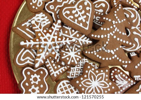 Homemade gingerbread cookies on a golden plate.