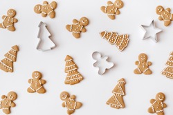 Homemade gingerbread cookies on white background. Christmas, winter, new year composition. Flat lay, top view