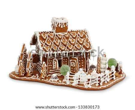 Homemade gingerbread house cottage isolated on white