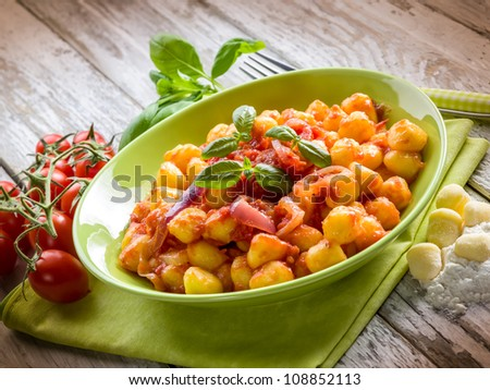 homemade gnocchi with tomato sauce basil and onions