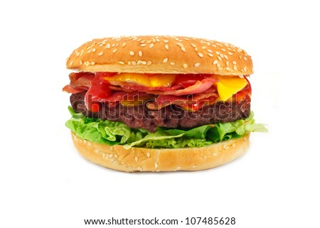 Homemade gourmet Bacon Cheeseburger a popular hamburger with bacon and cheese stacked on top inside a sesame seed bun