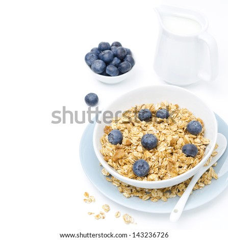 homemade granola, blueberries and jug of milk, isolated