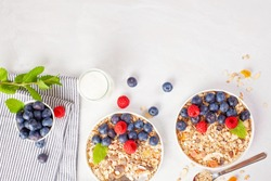 Homemade granola or oatmeal muesli with nuts, dried fruits and fresh berries. Healty diet breakfast, vegeterian food concept