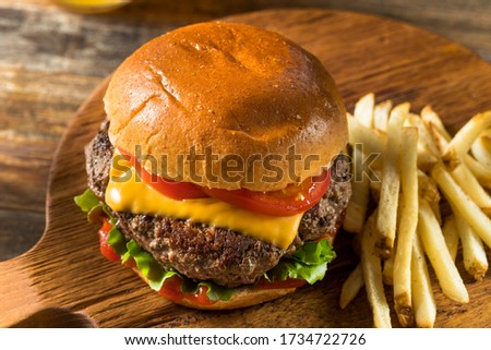 Homemade Grass Fed Cheeseburger with Fries and a Beer Сток-фото ©
