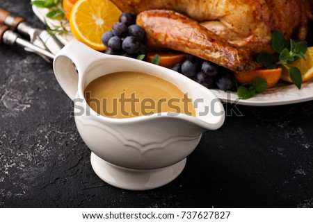 Homemade gravy in a sauce dish with turkey for Thanksgiving or Christmas Сток-фото ©