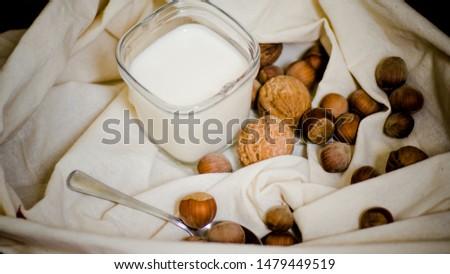 homemade greek yoghurt with walnut and  hazelnut nuts and peach