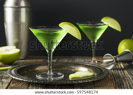 Homemade Green Alcoholic Appletini Cocktail with Apple Garnish #597548174