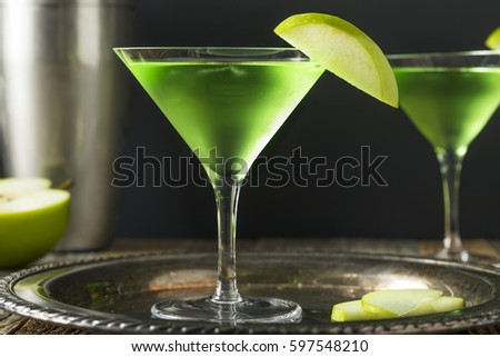 Homemade Green Alcoholic Appletini Cocktail with Apple Garnish #597548210