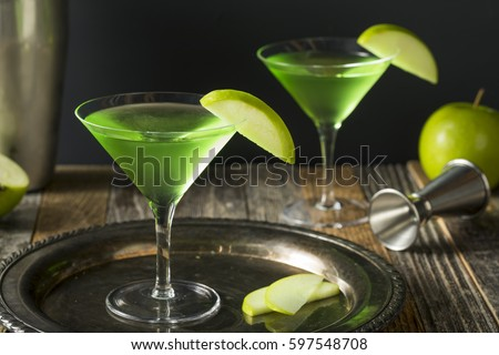 Homemade Green Alcoholic Appletini Cocktail with Apple Garnish #597548708