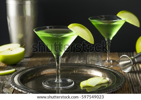 Homemade Green Alcoholic Appletini Cocktail with Apple Garnish #597549023