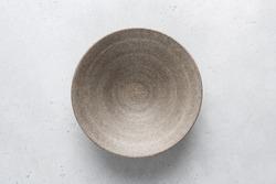 Homemade grey ceramic bowl. Craft ceramics, pottery concept
