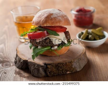 Homemade hamburger with fresh tomatoes, selective focus