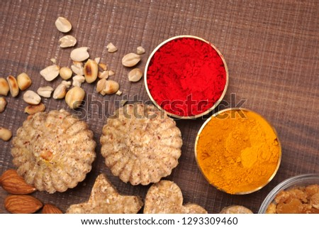 Homemade healthy and sweet groundnut or peanut and Jaggery Laddoo, delicious indian sweet served on a wooden background haldi Kumkum for Makar Sankranti festival.