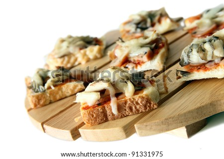 stock photo : Homemade healthy cutie pizza bread on top of wooden cutting board on white