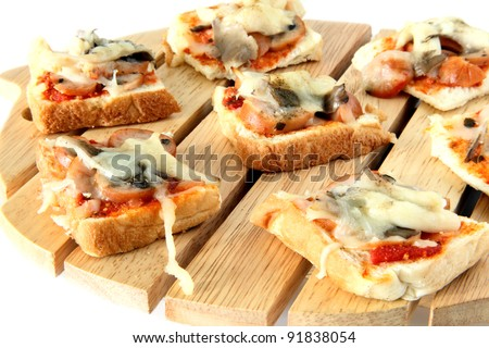 Homemade healthy cutie pizza bread on top of wooden cutting board on white - stock photo