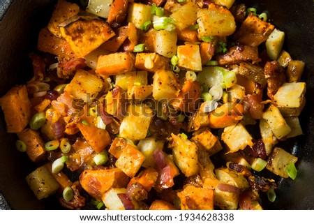 Homemade Healthy Sweet Potato Hash with Fried Eggs Stock photo ©