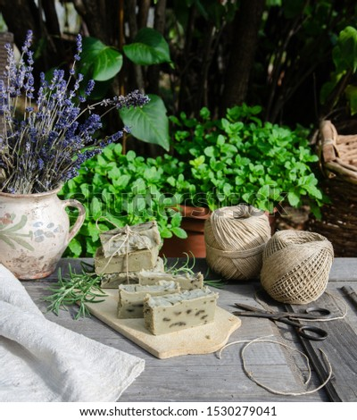 Homemade herbal soaps in rustic interior - lavender, mint, wooden tabble, garden - vintage style, shabby chic