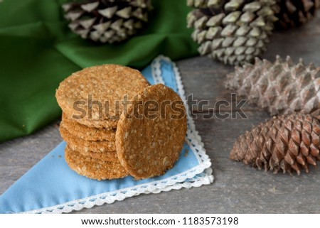 Homemade homemade cookies on rustic table and pineapples #1183573198