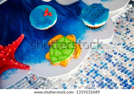 Homemade homemade gingerbread cookies in the form of crab, turtile, octopus and a starfish on the wooden table. Space for text and selective focus. #1319232689