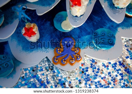 Homemade homemade gingerbread cookies in the form of crab, turtile, octopus and a starfish on the wooden table. Space for text and selective focus. #1319238374